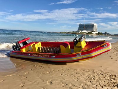 Pro Dive Boat on sand in Plettenberg Bay